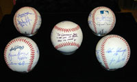 Five of the 15 balls autographed for KinderVision