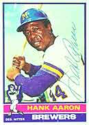 An autographed 1976 Topps Hank Aaron card.