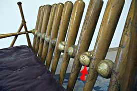 Red arrow indicates where Ty Cobb's <br>signature ball has been included in Ariss's bench.
