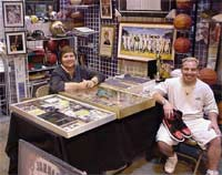 Carol and a friend with a few sports memorabilia treasures