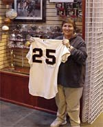 Carol and her prized game-used Barry Bonds 551st home run jersey