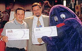 Dan Bernstein, Collectors Universe's David Hall and McDonald's Grimace.