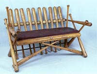 Folk Art Baseball Bench made from game used bats and baseballs - sold for $38,073.