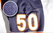 Repair marks such as this one(shown enlarged) may be used to photo-match game used jerseys.