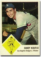 A 1963 Fleer ##42 Sandy Koufax <br>in PSA 9 realized $2,910.