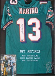 Michelin's home décor is made up of signed jerseys and 8x10 photos, including this presentation of Dan Marino items.