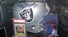Michelin likes to display his cards with other signed memorabilia pertaining to the player.