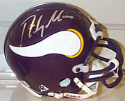 Randy Moss autographed mini helmet, at auction on Sports Collectors Universe until 8/22/99.