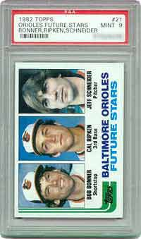 According to the Sportscard Market Report (SMR), this 1982 Topps Ripken rookie card <br>is estimated at $135 in PSA MT 9 and $1,350 in PSA Gem Mint 10.