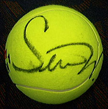 A tennis ball autographed by Serena Williams.