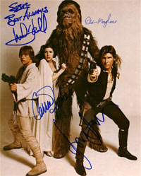 This image of autographs by Mark Hamill, Carrie Fisher, Peter Mayhew and Harrison Ford of the 1977 film, Star Wars, is part of the new, extensive and free information resource about autographs of entertainment, historical and sports figures, www.PSAAutographFacts.com.